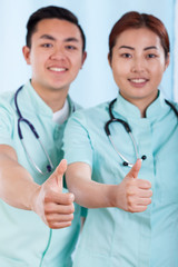 Couple of doctors with okay gesture