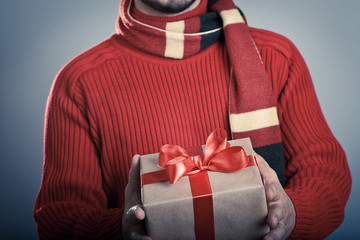 Male with red ribbon gift box