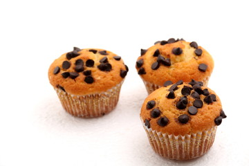 chocolate chip muffin on a white background.