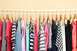 Leinwanddruck Bild - Colorful clothes on hangers in room