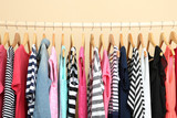 Colorful clothes on hangers in room - 73221969
