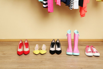 Different women shoes on floor in room