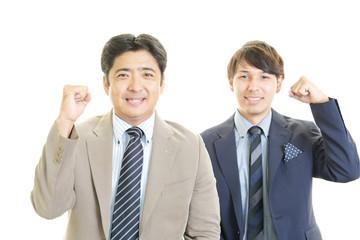 笑顔の二人のビジネスマン