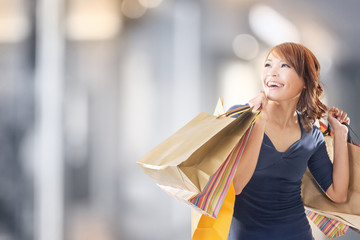 Cheerful shopping woman