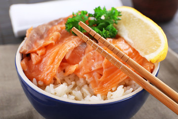 Bowl of boiled rice and fresh salted salmon