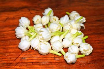 Group of white jasmine on wood