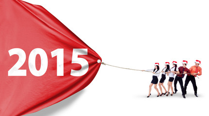 Business team pulling banner new year