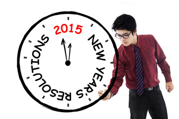 Businessman make clock for his resolution time