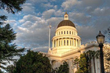 California Capitol building lit by setting sun