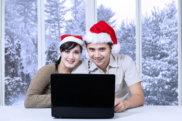 Couple using laptop for browsing internet