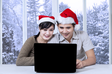 Couple using laptop for searching something