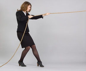 businesswoman pulling rope