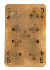 ancient used playing card of clubs with number 9