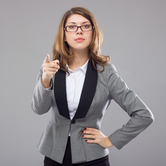 Business woman seriously gesturing finger at the viewer.