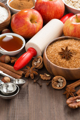ingredients for baking apple pie and wooden background, top view