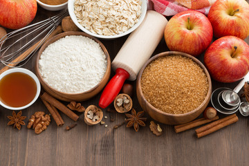 ingredients for baking cake on a wooden background, top view