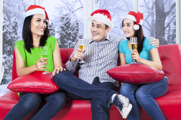 Group of teenagers celebrate christmas