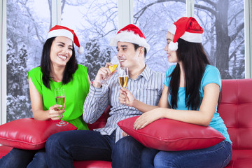 Group of young friends celebrate xmas