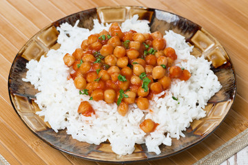 rice with chickpeas in tomato sauce on a plate