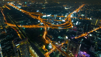 aerial view of highway and cityscape at night, Time lapse