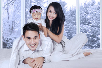 Hispanic family enjoy winter holiday at home