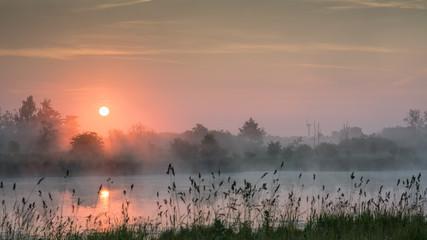Purple haze sunrise over a lake