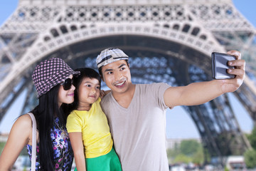 Tourist taking picture in eiffel tower