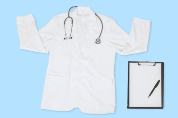 White doctor coat and clipboard