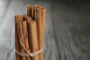 true cinnamon sticks on wooden table