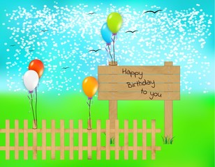 wooden desk with happy birthday text and balloons