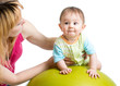 mother doing gymnastics with baby on fit ball