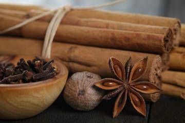 bunch of cinnamon sticks with nutmeg, anise and cloves