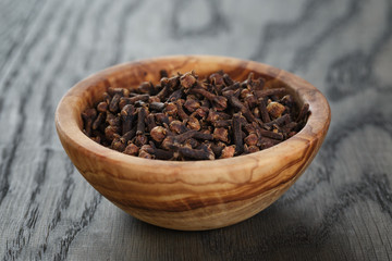 cloves in olive bowl on oak table
