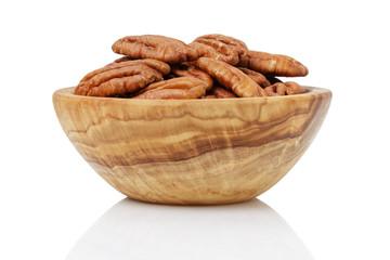 pekan nuts in wood bowl