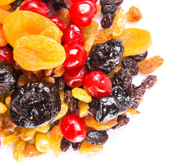 Mix variety of dried fruit over white background