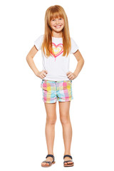 cheerful little girl with red hair in shorts and a T-shirt