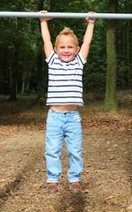 Happy boy on a trapeze.