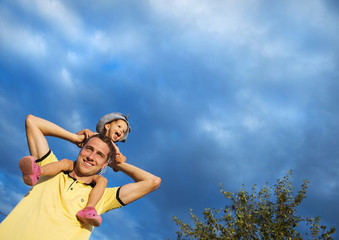 Father and daughter against the sky