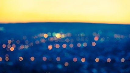 city blurring lights abstract circular bokeh blue background wit