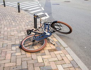 the bicycle thrown about  on street