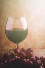 wine glass and red grapes