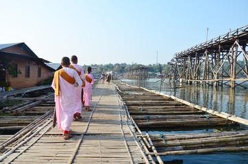Nun or ascetic women walking on Antique bamboo bridge