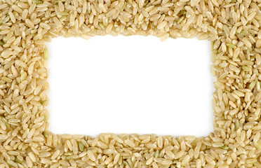 White copyspace surrounded by macro of whole brown rice grains