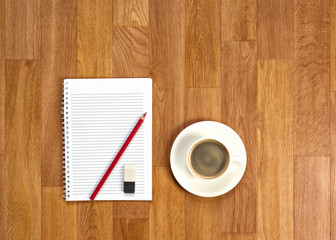 Blank Notepad with Office Supplies and Cup of Coffee.