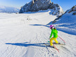 Skiing, winter, ski lesson - little skier on mountainside