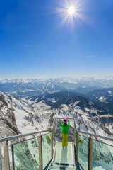 Skier girl on the viewing platform -  Alps