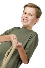 Boy pulls the rope
