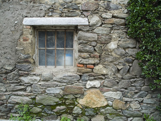 Rusty window with cobwebs