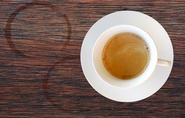 Top view of a cup of coffee on wooden table