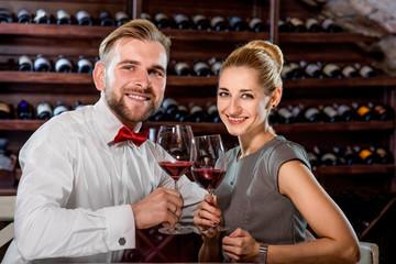 Couple having romantic wine tasting at the cellar